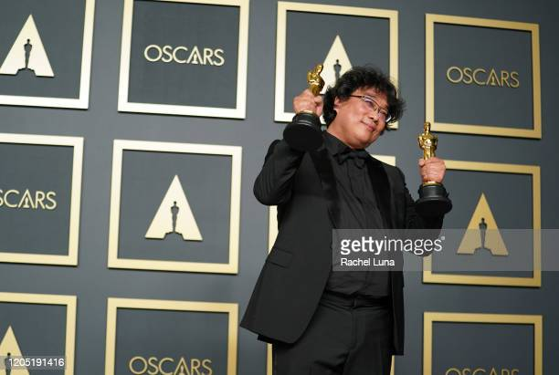 """Bong Joon-ho, winner of the Original Screenplay, International Feature Film, Directing, and Best Picture award for """"Parasite,"""" poses in the press..."""