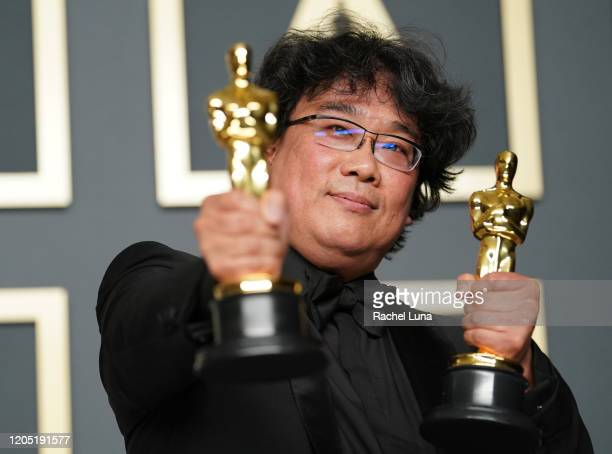 "Bong Joon-ho, winner of the Original Screenplay, International Feature Film, Directing, and Best Picture award for ""Parasite,"" poses in the press..."