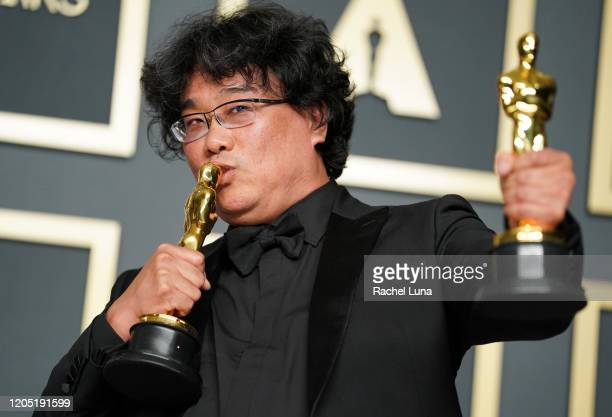 "Bong Joonho winner of the Original Screenplay International Feature Film Directing and Best Picture award for ""Parasite"" poses in the press room..."