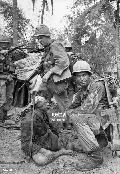 Bong Son South Vietnam Two soldiers of the U S First Cavalry Division drag a Viet Cong from a bunker January 29th during a sweep to the North of Bong...