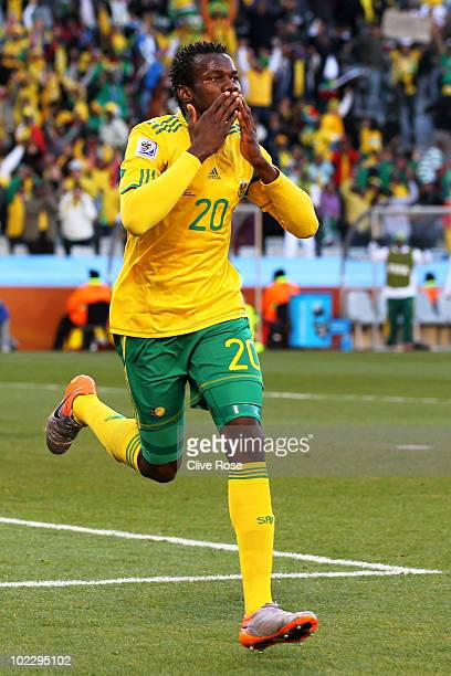 Bongani Khumalo of South Africa celebrates scoring the opening goal during the 2010 FIFA World Cup South Africa Group A match between France and...