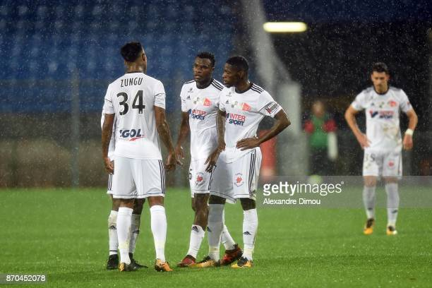 Bongani Zungu and Guy Massoma and Harisson Manzala of Amiens during the Ligue 1 match between Montpellier Herault SC and Amiens SC at Stade de la...