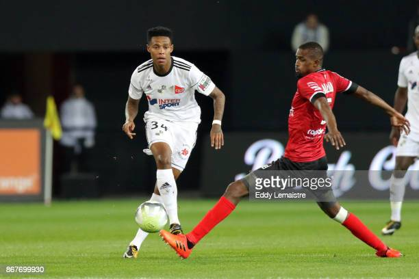 Bongani Zungu of Amiens and Moustapha Diallo of Guingamp during the Ligue 1 match between EA Guingamp and Amiens SC at Stade du Roudourou on October...