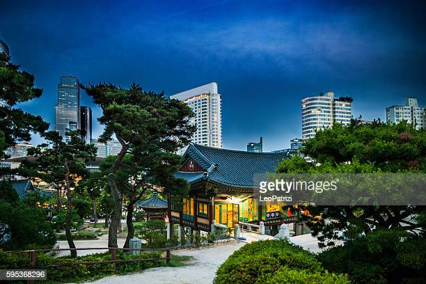 bongeunsa temple and seoul wtc skyline - temple building stock pictures, royalty-free photos & images