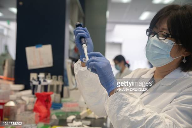 Bonghui Li works in a lab that is focused on fighting COVID-19 at Sorrento Therapeutics in San Diego, California on May 22, 2020. - Last Friday...