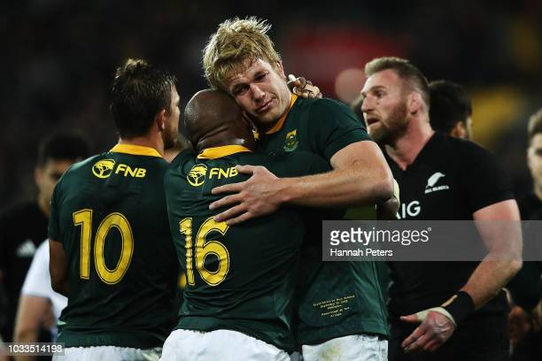 Bongi Mbonambi and PieterSteph du Toit of South Africa celebrate after winning The Rugby Championship match between the New Zealand All Blacks and...