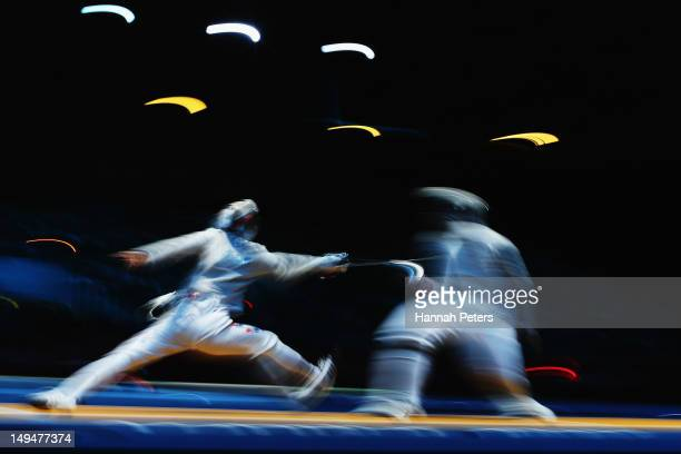 Bongil Gu of Korea and Max Hartung of Germany compete in the Men's Sabre Individual Fencing round 16 match against on Day 2 of the London 2012...