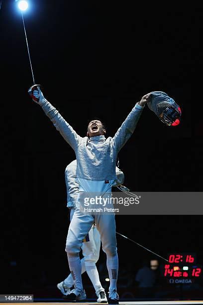 Bongil Gu of Korea celebrates winning the Men's Sabre Individual Fencing round of 32 match against Florin Zalomir of Romaina on Day 2 of the London...