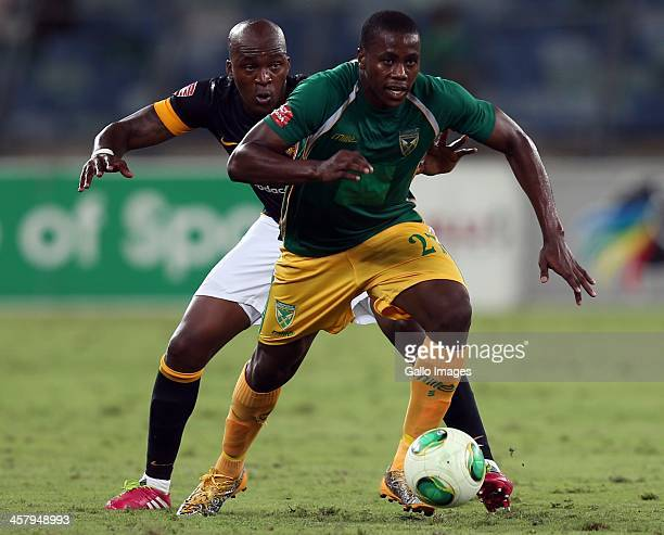 Bonginkosi Ntuli of Lamontville Golden Arrows holds off Morgan Gould of Kaizer Chiefs during the Absa Premiership match between Golden Arrows and...
