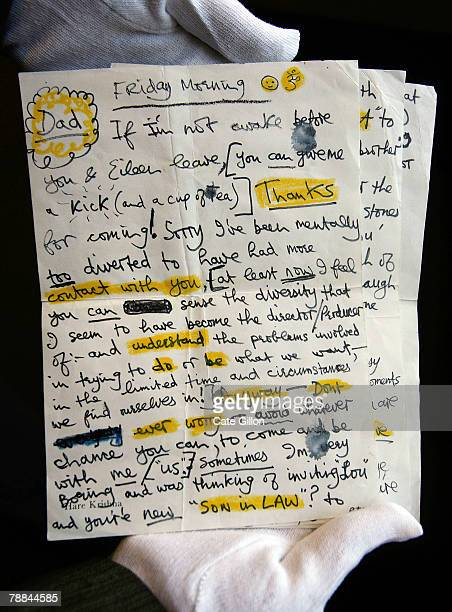 Bonhams' assistant holds a note from George Harrison to his father on January 9 2008 in London The letter is for sale at the Rock Pop and Film...