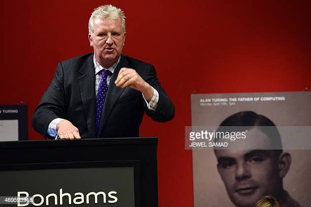 Bonhams cochief executive officer Patrick Meade administrates an auction of a handwritten manuscript belonging to British mathematician and World War...