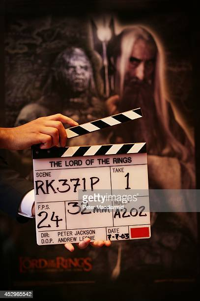 Bonhams employee holds a clapper board from 'The Lord of the Rings' movie trilogy on July 31 2014 in London England The board wrapped the very last...