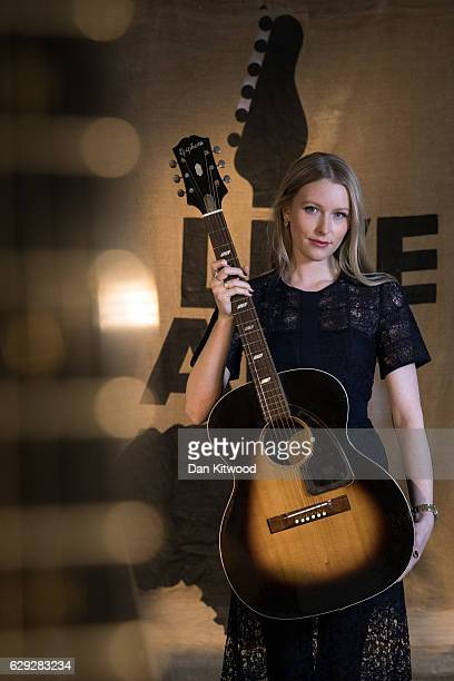 Bonhams employee holds a Epiphone acoustic guitar in a Sunburst finish once owned by the late musical artist Jimi Hendrix, during a press preview of...