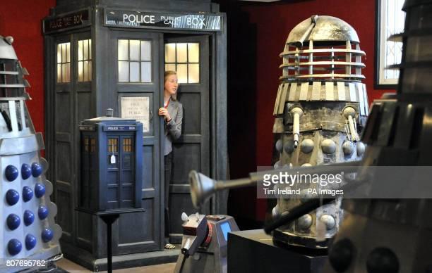 Bonhams employee Katherine Boyle emerges from the TARDIS used to transport the ninth incarnation of Dr Who Christopher Eccleston into Bonhams in...