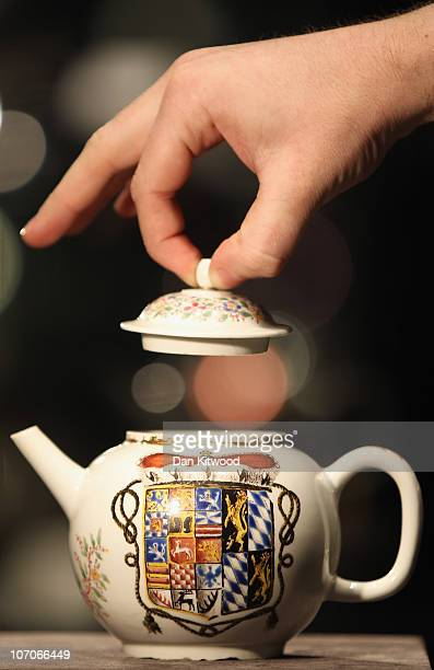 Bonhams employee lifts the lid on a porcelain teapot dated 171314 at Bonhams Auction house on November 22 2010 in London England The teapot which is...