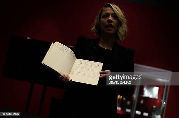 Bonhams' History of Science and Technology department director Cassandra Hatton shows a handwritten manuscript belonging to British mathematician and...