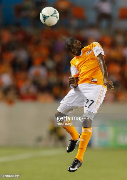 Boniek Garcia of Houston Dynamo heads the ball away from the Chicago Fire at BBVA Compass Stadium on July 27 2013 in Houston Texas