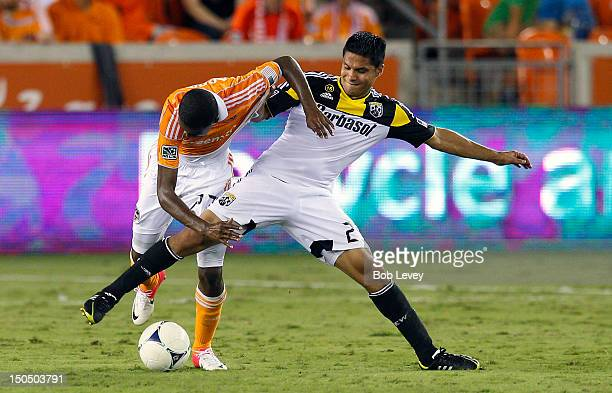 Boniek Garcia of the Houston Dynamo and Jairo Arrieta of Columbus Crew fight for possession of the ball at BBVA Compass Stadium on August 19 2012 in...