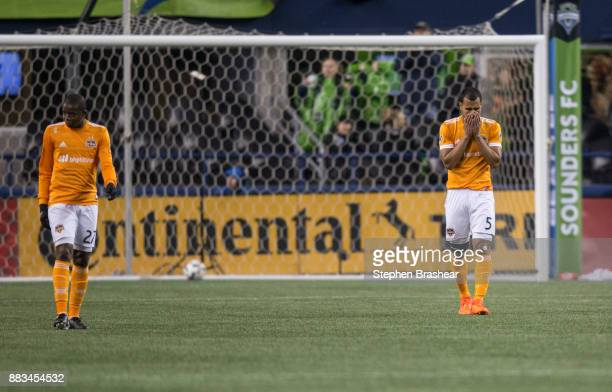Boniek Garcia of the Houston Dynamo and Juan Cabezas of the Houston Dynamo react after a goal by Will Bruin of the Seattle Sounders during the second...