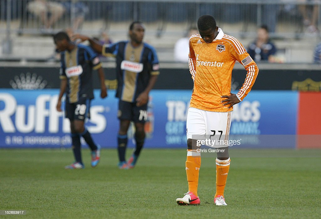 Boniek Garcia #27 of the Houston Dynamo reacts as he walks off the field as Raymon Gaddis #28 and Omobi Okugo #14 of the Philadelphia Union congratulate each other after their win at PPL Park on September 23, 2012 in Chester, Pennsylvania. The Union won 3-1.