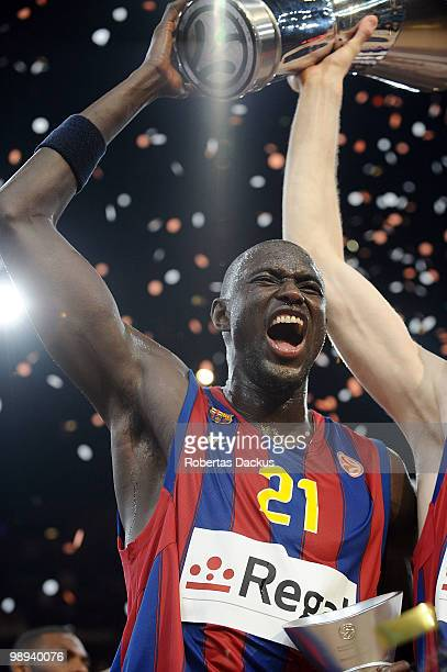 Boniface Ndong of Regal FC Barcelona celebrates with the trophy during the 2009-2010 Euroleague Basketball Champion Awards Ceremony at Bercy Arena on...