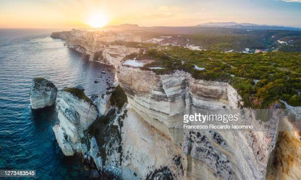 bonifacio, corsica, france. sunset over cliffs and town. - francesco riccardo iacomino france foto e immagini stock
