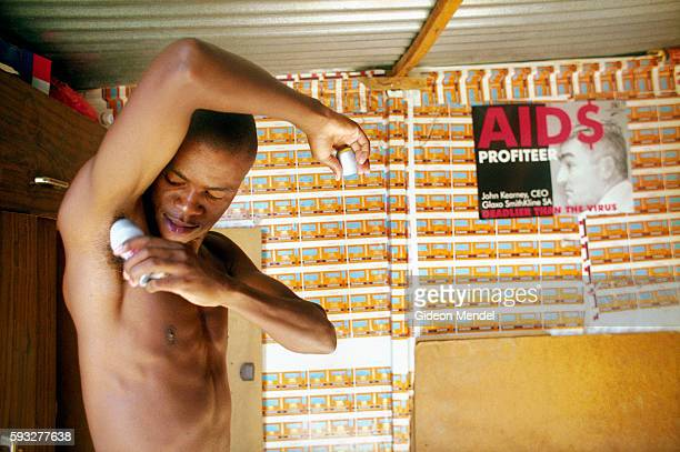 Bonile Peter puts on deodorant before leaving his small squatter shack in Khayelitsha near Cape Town South Africa An HIVpositive AIDS activist he was...