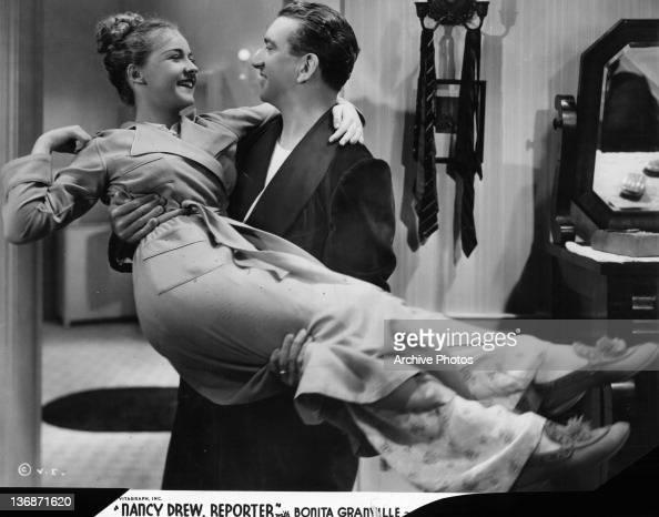 Bonita Granville Is Carried By John Litel In A Scene From