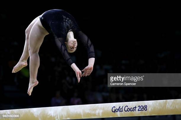 Bonita Shurmer of Jersey competes on the beam during the Gymnastics Artistic Women's Team Final and Individual Qualification on day two of the Gold...