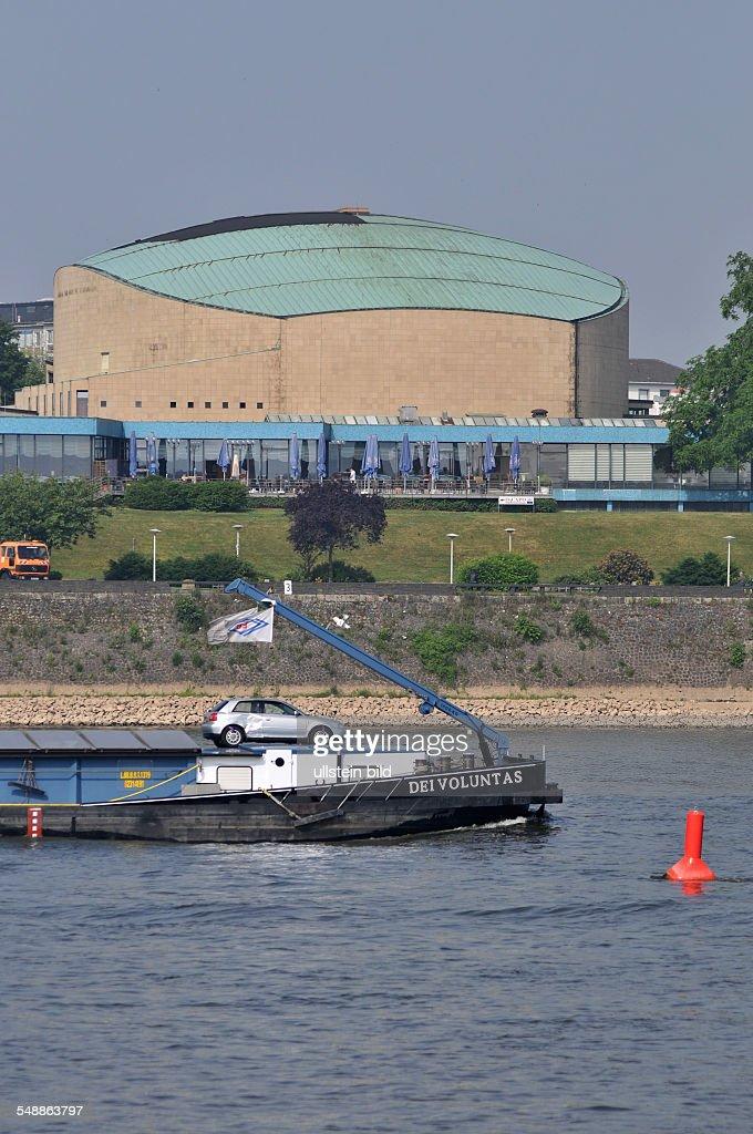 Bonn 20.05.2011: Beethovenhalle Halle Musikhalle Musiksaal Veranstaltungshalle Ansicht außen Außenansicht Gebäude Rhein Fluß Schiff Frachter Frachtschiff : News Photo