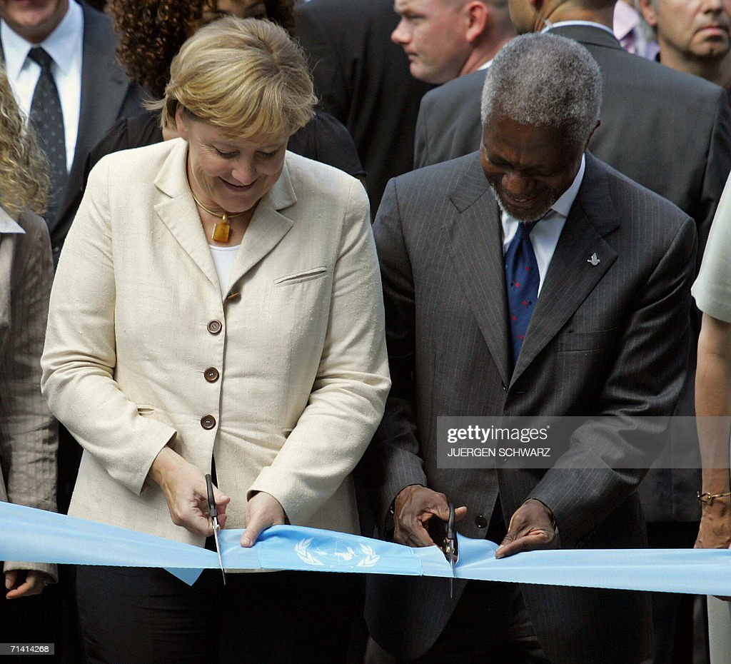 German Chancellor Angela Merkel and UN Secretary General Kofi Annan cut the ribbon to open a new UN campus 11 July 2006 in Bonn, western Germany. Annan said in a press conference before that certain 'major powers' should play a bigger role in the world body but declined to name favorites for any new permanent seats on the Security Council.