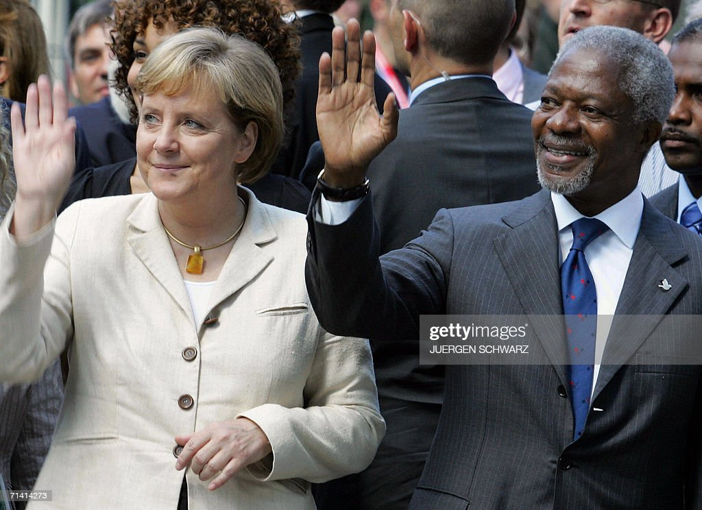 German Chancellor Angela Merkel and UN Secretary General Kofi Annan wave as they open a new UN campus 11 July 2006 in Bonn, western Germany. Annan said in a press conference before that certain 'major powers' should play a bigger role in the world body but declined to name favorites for any new permanent seats on the Security Council.