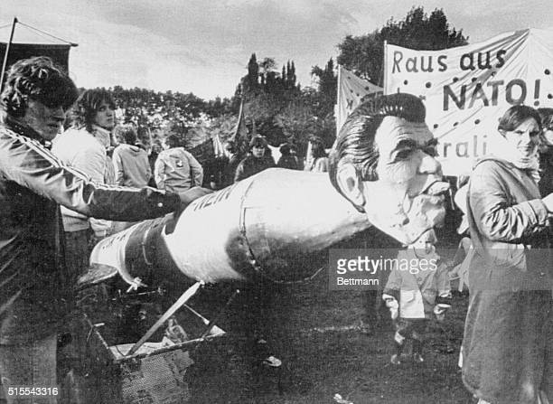"""Bonn: President Reagan watched as warhead of a dummy missile, in the controversial """"Peace"""" rally against stationing of U.S. Missiles in Europe...."""