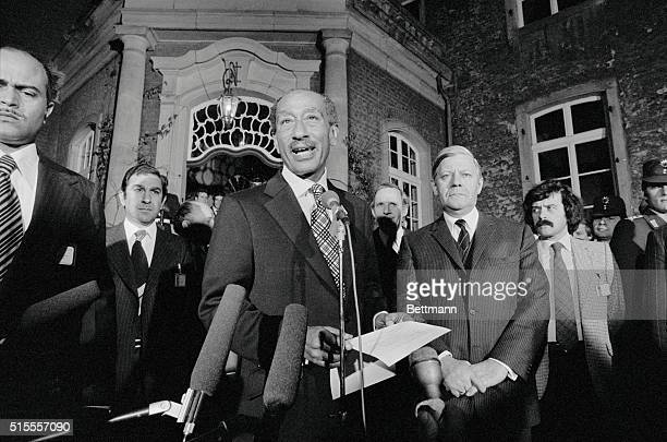 With West German Chancellor Helmut Schmidt listening at right President Anwar Sadat of Egypt makes a statement before a dinner given at government...