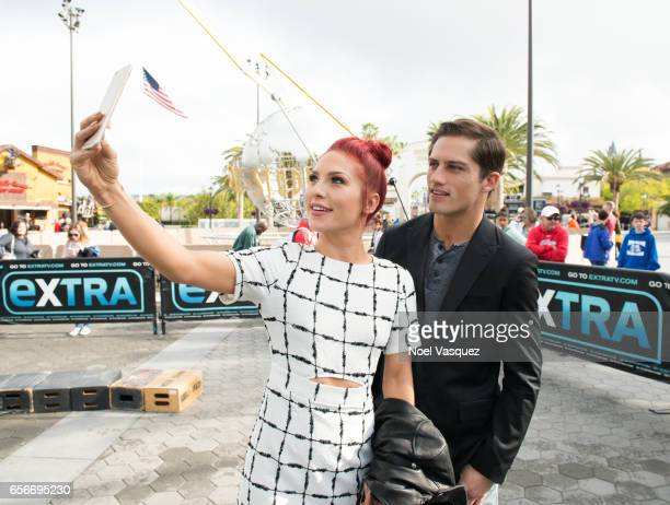 Bonner Bolton and Sharna Burgess take a selfie at 'Extra' at Universal Studios Hollywood on March 22 2017 in Universal City California