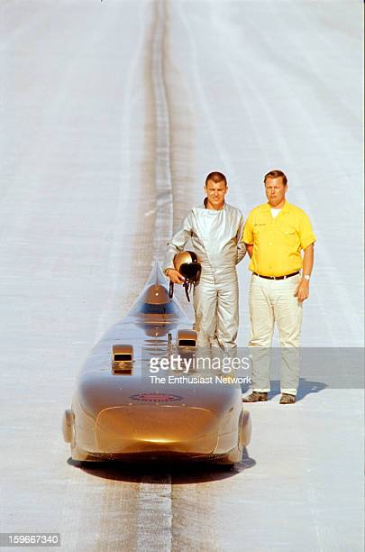 Bonneville National Speed Trials Salt Flats Bill and Bob Summersstand alongside their record setting the Summers Brothers Golden Rod streamliner on...