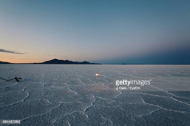 Bonneville Salt Flats Against Blue Sky During Sunset