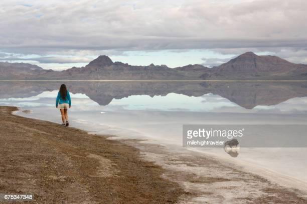 bonneville salt flats silver island mountains desert reflection woman explores utah - great salt lake stock pictures, royalty-free photos & images
