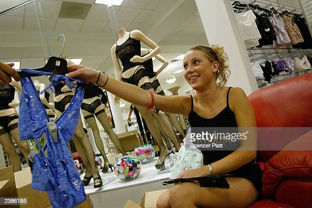Bonnie an employee at the Penthouse Boutique tags new merchandise August 10 2003 in Milford Connecticut The Penthouse Boutique which is not owned by...