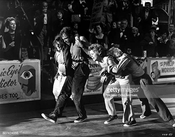 Bonnie Bedelia Bruce Dern Jane Fonda and Red Buttons walk off the dance floor in a scene from the movie 'They Shoot Horses Don't They' circa 1969