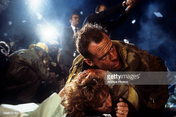 Bonnie Bedelia is held down by Bruce Willis in a scene from the film 'Die Hard' 1988