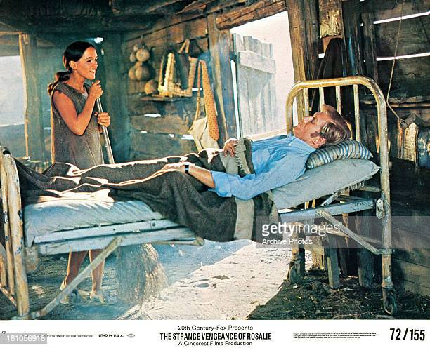 Bonnie Bedelia sweeping the floor as Anthony Zerbe lays in bed in a scene from the film 'The Strange Vengeance Of Rosalie' 1972