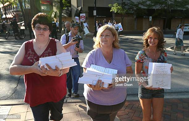 Bonnie Borman Cheryl Randecker and Pamela Lampros deliver a petition with more than 35000 signatures to the offices of Bain Capital urging the...
