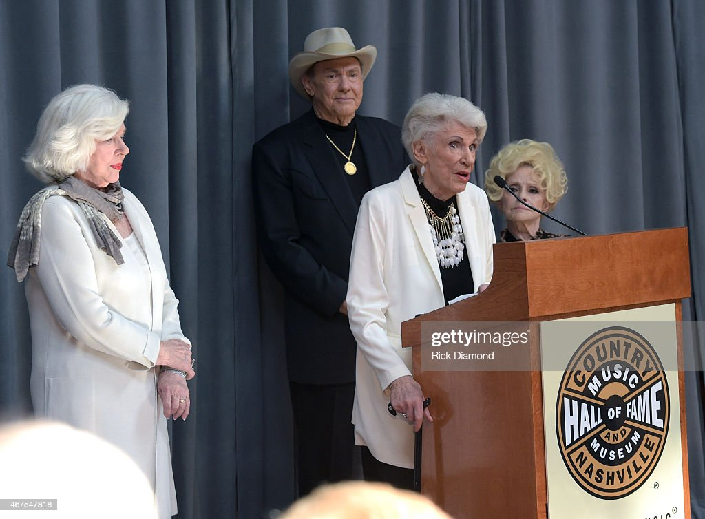 Bonnie Brown, Jim Ed Brown, Maxine Brown of Jim Ed Brown and The Browns are welcomed into the Country Music Hall of Fame as Country & Rock & Roll Hall of Fame member/Host and Brenda Lee looks on during the CMA Announcement that JIM ED BROWN and THE BROWNS, GRADY MARTIN and THE OAK RIDGE BOYS are the NEWEST MEMBERS OF THE COUNTRY MUSIC HALL OF FAME at Country Music Hall of Fame and Museum on March 25, 2015 in Nashville, Tennessee.