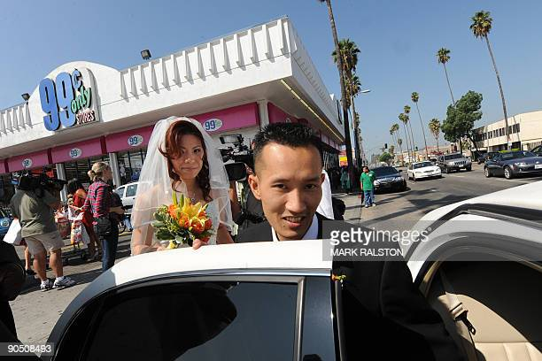 Bonnie Cam and Jon Nguyen board a limousine after their 99 cent wedding ceremony held at the 99 cent store in Los Angeles on September 9 2009 The...