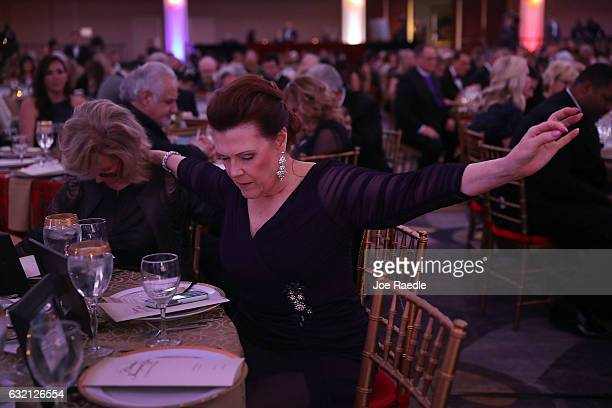 Bonnie Chava prays during the invocation at the start of the Women for a Great America Christian Inaugural Gala on January 19 2017 in Washington DC...
