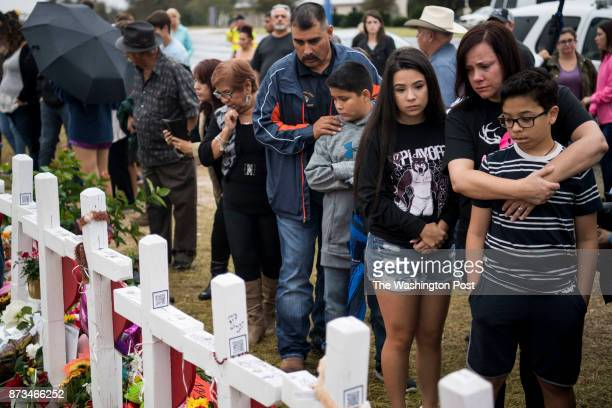 Bonnie Cortez of nearby Floresville Texas and her children Madison Cortez and Vincent Cortez right visit the memorial crosses near the Sutherland...