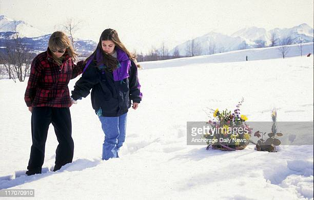 Bonnie Craig's friend from Service High Janarose Odenheimer and mother Karen Campbell place flowers by her grave marking what would have been Craig's...