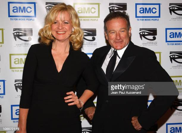 Bonnie Hunt and Robin Williams during The 19th Annual American Cinematheque Award Honoring Steve Martin Arrivals at Beverly Hilton Hotel in Beverly...