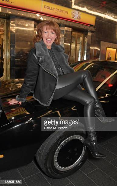 Bonnie Langford poses with KITT from Knight Rider at the gala party to celebrate David Hasselhoff joining the cast of the West End production of 9 To...